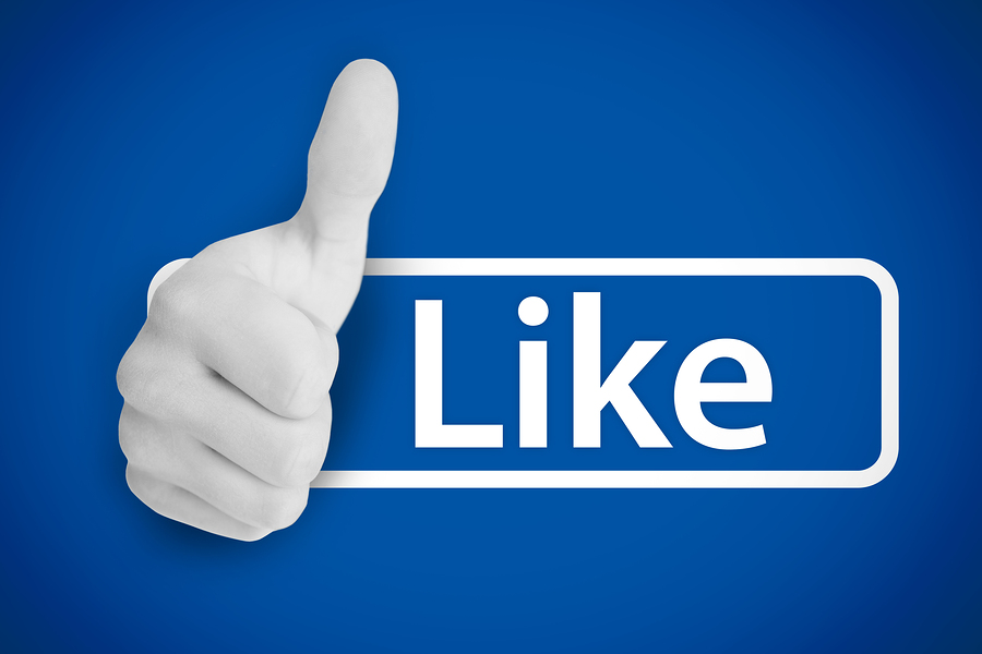 White thumb up next to the like from social networks on blue background